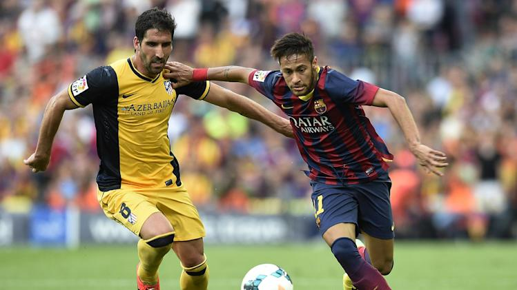 Neymar (right) fends off Koke during Barcelona's Spanish League game against Atletico Madrid at the Camp Nou stadium on May 17, 2014