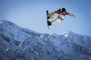 U.S. snowboarder White goes off a jump during snowboard slopestyle training at the 2014 Sochi Winter Olympics in Rosa Khutor