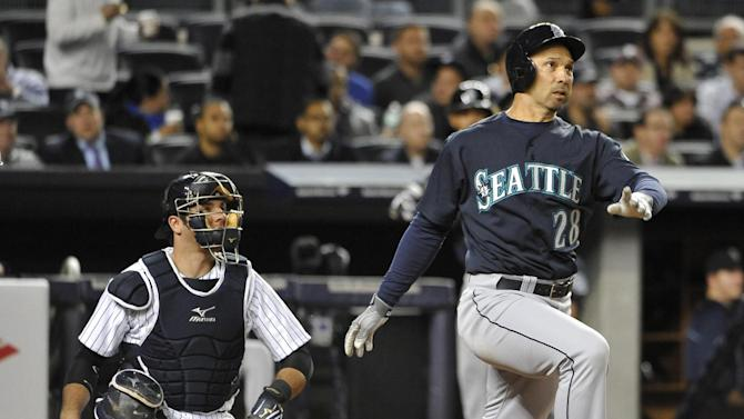 Seattle Mariners' Raul Ibanez (28) and New York Yankees catcher Austin Romine watch Ibanez's two-run home run off CC Sabathia in the sixth inning of a baseball game at Yankee Stadium on Tuesday, May 14, 2013, in New York. (AP Photo/Kathy Kmonicek)