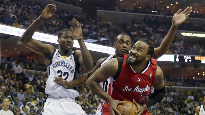 Los Angeles Clippers' Ronny Turiaf (21), of France, tries to  go to the basket as Memphis Grizzlies' Ed Davis (32) and Darrell Arthur defend during the first half of Game 4 in a first-round NBA basketball playoff series in Memphis, Tenn., Saturday, April 27, 2013. (AP Photo/Danny Johnston)