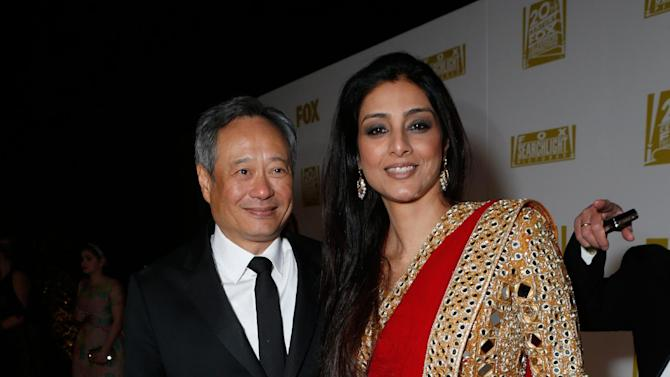Director Ang Lee, left, and actress Tabu attend the Fox Golden Globes Party on Sunday, January 13, 2013, in Beverly Hills, Calif. (Photo by Todd Williamson/Invision for Fox Searchlight/AP Images)