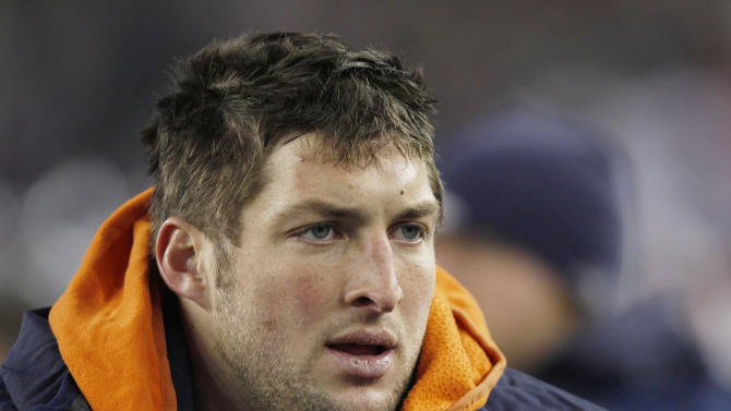 Denver Broncos quarterback Tim Tebow watches from the sidelines during the first half of an NFL divisional playoff football game against the New England Patriots Saturday, Jan. 14, 2012, in Foxborough, Mass. (AP Photo/Charles Krupa)