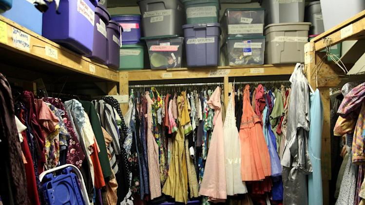 This Thursday, Aug. 16, 2012, photo shows one of the packed rooms in the costume collection at the summer camp Stagedoor Manor in Loch Sheldrake, N.Y. The camp, open to kids from 10 to 18, boats some famous alumni, including Natalie Portman, Jon Cryer, Robert Downey Jr., Lea Michele, Mandy Moore and Zach Braff. (AP Photo/Mark Kennedy)