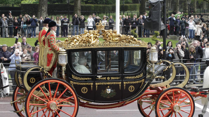Britain's Queen Elizabeth II on a carriage departs Buckingham Palace on her way to  the Houses of Parliament for the State Opening, in London, Wednesday, May 9, 2012. Announcing the government's new legislative program Wednesday in an opulent pageant of pomp and politics, the queen said planned laws would introduce a smaller, mainly upper elected chamber. (AP Photo/Lefteris Pitarakis)