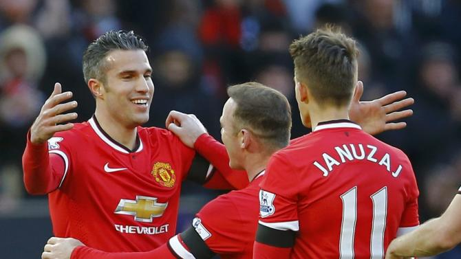 Manchester United's Robin van Persie celebrates his goal during their English Premier League soccer match against Leicester City at Old Trafford in Manchester