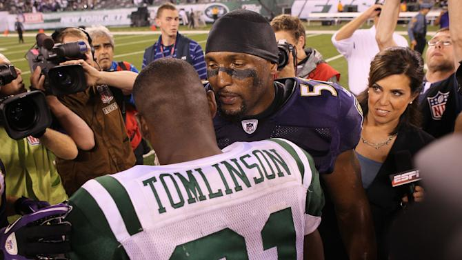 EAST RUTHERFORD, NJ - SEPTEMBER 13: Ray Lewis #52 of the Baltimore Ravens talks to LaDainian Tomlinson #21 of the New York Jets after defeating the New York Jets in their home opener at the New Meadowlands Stadium on September 13, 2010 in East Rutherford, New Jersey. (Photo by Jim McIsaac/Getty Images)
