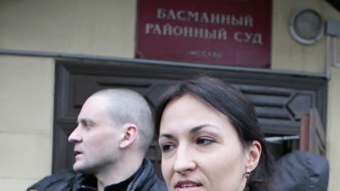 Russian opposition leader Sergei Udaltsov, left, walks with his wife Anastasya while waiting for judge's sentence at a Moscow court in Moscow, Russia, Saturday, Feb. 9, 2013. Udaltsov, a top Russian opposition figure, has been placed under house arrest for two months, a move that also bans him from using most forms of communication, including the Internet, telephone and mail. A Moscow court imposed the restrictions Saturday after prosecutors complained he had violated a previous agreement not to leave Moscow. (AP Photo/Mikhail Metzel)