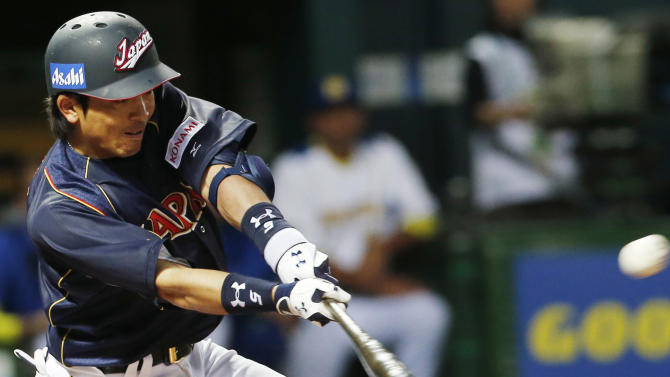 Japan's infielder Nobuhiro Matsuda hits an RBI single off Brazil's pitcher Kesley Kondo in the eighth inning of their World Baseball Classic first round game in Fukuoka, Japan, Saturday, March 2, 2013. (AP Photo/Koji Sasahara)