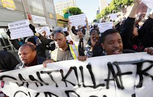 Protestors rally in downtown Los Angeles, against a …