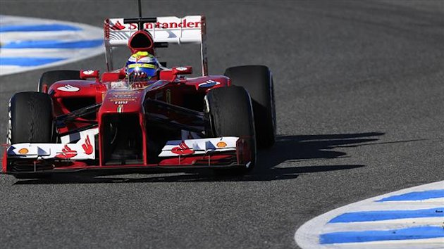 Ferrari Formula One driver Felipe Massa of Brazil takes a curve as he drives the new F138 during a training session at the Jerez racetrack in southern Spain (Reuters)