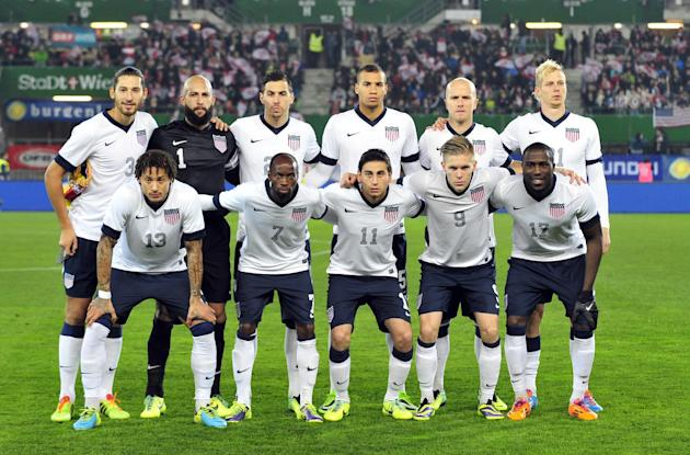In this Nov. 19, 2013 file photo, the United States national soccer team poses prior to the start their friendly soccer match between Austria and the United States in Vienna, Austria. Background from
