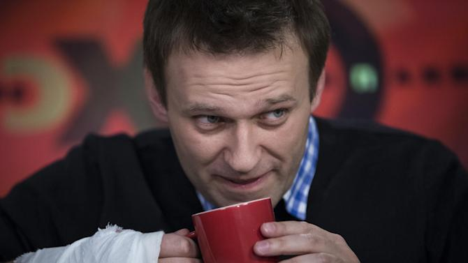 Russian opposition leader Alexey Navalny drinks tea while speaking to a journalist during an interview in the Echo Moskvy (Echo of Moscow) radio station in Moscow, Russia, Monday, April 8, 2013. Navalny made his name as an anti-corruption whistleblower and spearheaded massive anti-Kremlin protests that followed the rigged parliament election in Dec. 2011. (AP Photo/Alexander Zemlianichenko)
