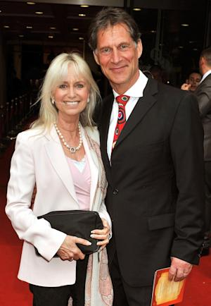 """FILE - This file photo of May 24, 2010 shows actor Simon MacCorkindale with his wife Susan George in London. Simon MacCorkindale, an actor who starred on British television in """"Casualty"""" and in the United States in """"Falcon Crest,"""" has died at age 58. MacCorkindale died Thursday Oct. 14, 2010 of bowel cancer in a London clinic publicist Max Clifford said.   (AP Photo/John Stillwell/PA Wire)  ** UNITED KINGDOM OUT  **"""