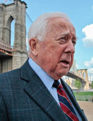 "FILE - In this May 10, 2012 file photo, author David McCullough, two-time Pulitzer Prize winner for books ""Truman"" and ""John Adams,"" walks around the Brooklyn Bridge while being interviewed in New York. A Pittsburgh bridge has been renamed for Pulitzer Prize-winning historian David McCullough on his 80th birthday. County officials gathered Sunday, July 7, 2013 to rename the 16th Street Bridge in McCullough's honor. A Pittsburgh native and two-time Pulitzer prize winner, he says no honor has touched him like the decision to rename the bridge after him. McCullough, who wrote a book about the construction of the Brooklyn Bridge, says there's ""something special about a bridge."" (AP Photo/Bebeto Matthews, File)"