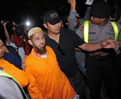 Umar Patek (wearing orange shirt) was one of Asia&amp;#39;s most wanted terror suspects and had a $1 million bounty