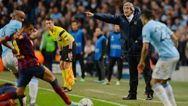 Manchester City manager Manuel Pellegrini instructs his team against Barcelona in the Champions League (AFP)