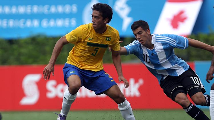 Brazil's  Lucas Goncalves, left, is chased by Argentina's Michael Hoyos during a men's soccer match at the Pan American Games in Guadalajara, Mexico, Wednesday, Oct. 19, 2011. (AP Photo/Juan Karita)