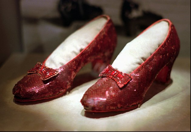 FILE - In this April 10, 1996 file photo, the ruby slippers worn by Judy Garland in the 1939 film &quot;The Wizard of Oz&quot; are shown on display during a media tour of the &quot;America&#39;s Smithsonian&quot; exhibition in Kansas City, Mo. The ruby slippers are leaving the U.S. on their first international journey to London&#39;s Victoria and Albert Museum. (AP Photo/Ed Zurga)