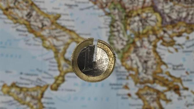 A damaged one Euro coin is placed over a map of southern Europe in this illustration photo taken in Warsaw September 14, 2012. REUTERS/Kacper Pempel/Files