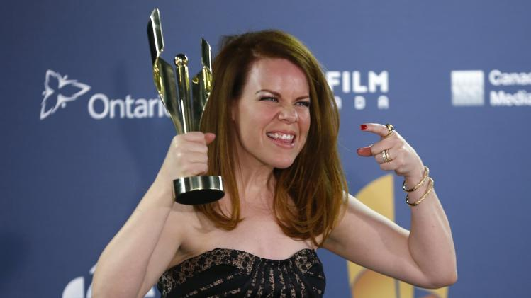 "Actress Tracy Dawson holds her award for Best Performance by a Lead Comedic Role for ""Call Me Fitz"" at the 2014 Canadian Screen awards in Toronto"