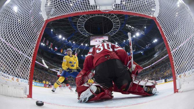 Sweden's Lindholm scores a goal past Austria's goaltender Swette during their Ice Hockey World Championship game at the O2 arena in Prague
