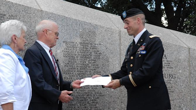 This photo provided by Lt. Col. Jose Garcia shows U.S. Army Lt. Col. Townley Hedrick, a representative of the 101st Airborne Divisioin, presents four letters from Sgt. Steve Flaherty to his sister-in-law Martha Gibbons and uncle Kenneth Cannon on Saturday, July 14, 2012,  at a ceremony in Columbia, S.C. Flaherty wrote the letters before he was killed in Vietnam in 1969 and they were preserved by the Vietnamese after they were found on his body. Defense Secretary Leon Panetta was given the letters during a visit to Vietnam last month. (AP Photo/Lt. Col. Jose Garcia)