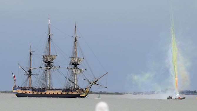 Fireworks crackle around the replica of the frigate Hermione, used to bring French troops and funds to American revolutionaries in 1780, sails near Fouras, southwest France, on his way for its transatlantic voyage, Saturday, April 18, 2015. The voyage, rich with diplomatic symbolism, will take the 65-meter (213-foot) Hermione along the same path its namesake took under France's Marquis de Lafayette's command 235 years ago, retracing a journey that laid the foundation of French-American relations. (AP Photo/Francois Mori)