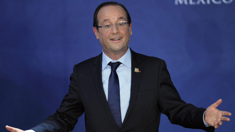 France's President Francois Hollande reacts at the end of a news conference at the G-20 summit in Los Cabos, Mexico, Tuesday, June 19, 2012. (AP Photo/Andres Leighton)