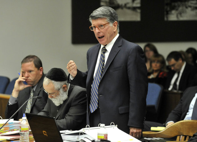 Defense attorney John D. Barnett, who is representing Fullerton police officer Manuel Ramos, in the beating death of Kelly Thomas, a homeless man in Fullerton, cross-examines a witness during a preliminary hearing in Santa Ana, Calif., Monday, May 7, 2012. Ramos, a 10-year-veteran of the department, is accused of second-degree murder and involuntary manslaughter. (AP Photo/The Orange County Register, Joshua Sudock, Pool)