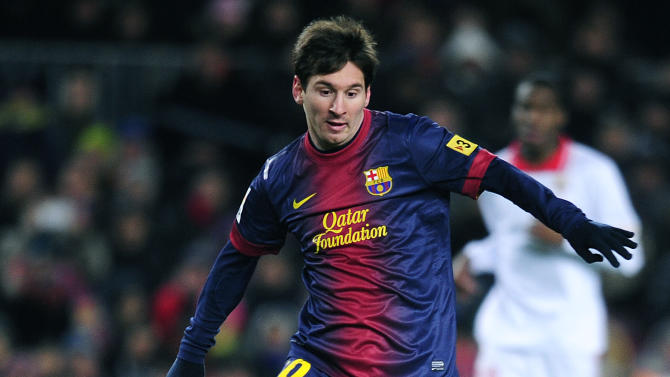 FC Barcelona's Lionel Messi, from Argentina, right, duels for the ball with Sevilla's Alberto Botia during a Spanish La Liga soccer match at the Camp Nou stadium in Barcelona, Spain, Saturday, Feb. 23, 2013. (AP Photo/Manu Fernandez)