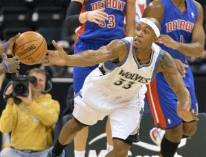 Minnesota Timberwolves' Cunningham and Detroit Pistons' Bynum reach for a rebound during their NBA pre-season basketball game in Winnipeg in this file photo