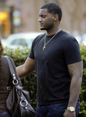 Rolando McClain, a linebacker for the Oakland Raiders and a former University of Alabama player, leaves the Decatur City Jail, Tuesday, Jan. 8, 2013, in Decatur, Ala. McClain has bonded out jail on charges stemming from a window tint violation and providing false information to police. (AP Photo/The Decatur Daily, Brennen Smith)