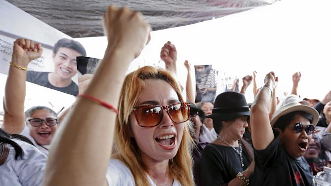Members of the New Democracy Movement activist group and supporters of the 14 students who had been held for holding anti-coup protests, celebrate outside the military court in Bangkok, Thailand
