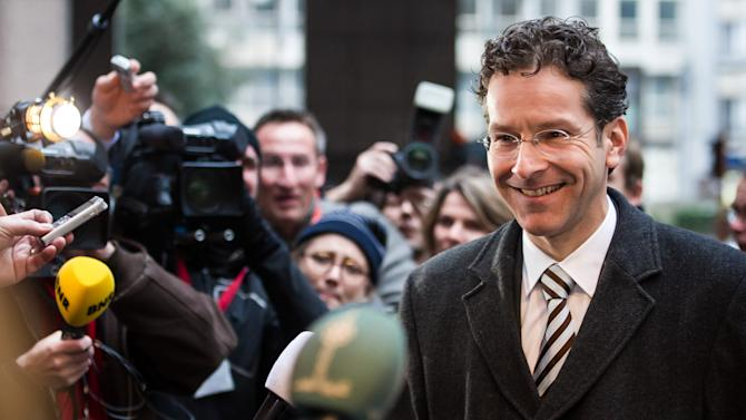 Dutch Finance Minister Jeroen Dijsselbloem talks with journalists as he arrives for an Eurogroup finance ministers meeting at the EU Council in Brussels on Monday, Jan. 21, 2013. (AP Photo/Geert Vanden Wijngaert)