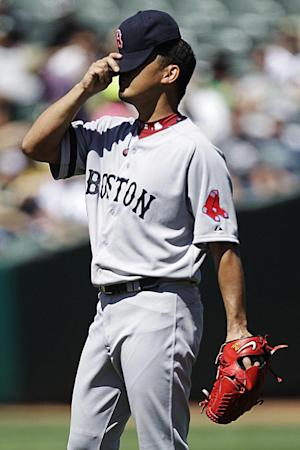 Boston Red Sox's Daisuke Matsuzaka, of Japan, adjusts his cap in the second inning of a baseball game against the Oakland Athletics, Sunday, Sept. 2, 2012, in Oakland, Calif. (AP Photo/Ben Margot)
