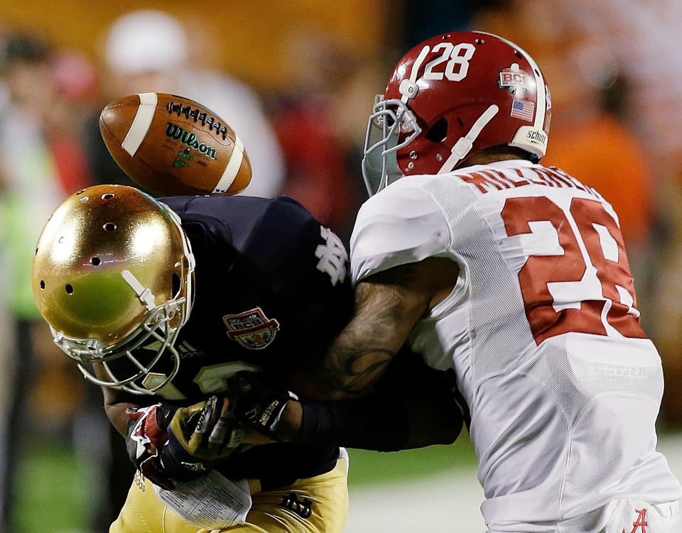 Alabama's Dee Milliner (28) breaks up a pass intended for Notre Dame's DaVaris Daniels during the first half of the BCS National Championship college football game Monday, Jan. 7, 2013, in Miami. (AP Photo/Chris O'Meara)