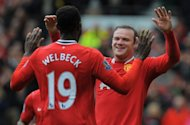 Manchester United forward Wayne Rooney (R) celebrates after scoring during a Premier League match on April 22. United are left clinging to the hope that City&#39;s historical reputation as masters of shooting themselves in the foot will re-emerge against QPR