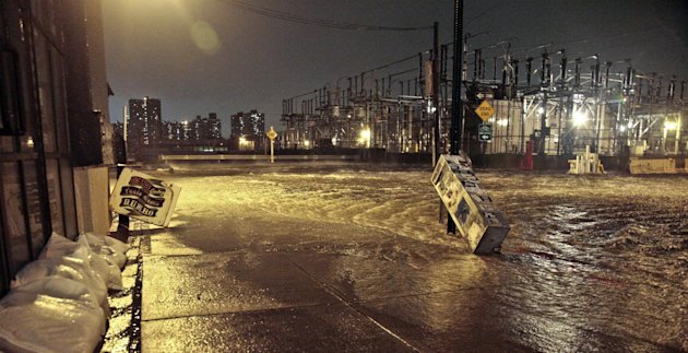 Streets around a Con Edison substation are flooded as the East River overflows into the Dumbo section of Brooklyn, N.Y., as Sandy moves through the area on Monday, Oct. 29, 2012. After a gigantic wall of water defied elaborate planning and swamped underground electrical equipment at a Consolidated Edison substation in Manhattan&#39;s East Village, about 250,000 lower Manhattan customers were left without power. (AP Photo/Bebeto Matthews)