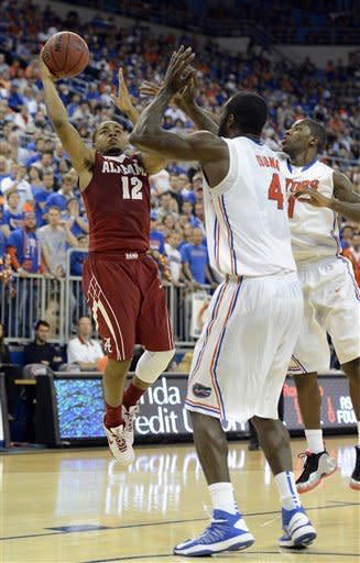 No. 8 Florida rallies to beat Alabama 64-52