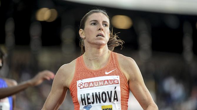Zuzana Hejnova of the Czech Republic competes to win the women's 400m hurdles event at the IAAF Athletics Diamond League meeting at Stockholm Olympic Stadium