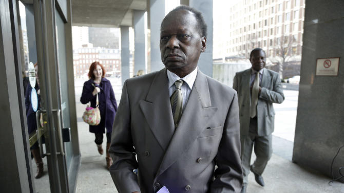 In this Dec. 3, 2013, photo Onyango Obama, President Barack Obama's Kenyan-born uncle, arrives at U.S. Immigration Court for a deportation hearing. The White House said Dec. 5, that President Barack Obama briefly lived with an uncle who faced deportation from the United States, correcting its previous statements that the president had never met Onyango Obama. The 69-year-old, Kenyan-born half-brother of Obama's estranged father was granted permission this week to stay in the U.S. after ignoring a deportation order two decades ago. (AP Photo/Steven Senne)