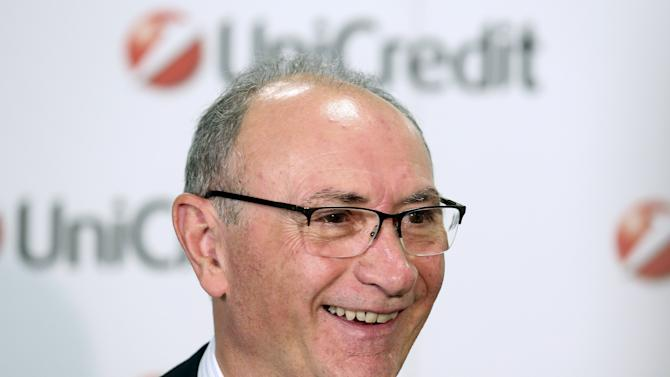 UniCredit bank CEO Ghizzoni smiles as he waits for an TV interview at the headquater downtown Milan