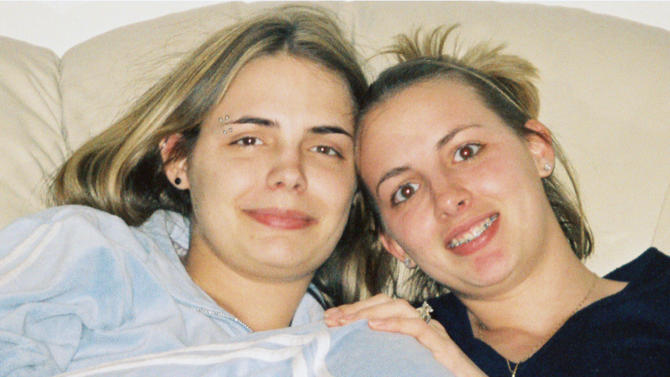 FILE - In this undated file photo provided by the Stacy Peterson family, Stacy Peterson, 23, right, of Bolingbrook, Ill., is seen with her younger sister Cassandra Cales. Peterson, the wife of Drew Peterson, a sergeant with the Bolingbrook Police Department, was reported missing Oct. 29, 2007. On Tuesday, July 31, 2012, opening statements are slated in the much-anticipated trial of the 58-year-old Peterson, who was charged with the 2004 murder of his 40-year-old third wife, Kathleen Savio, only after his fourth wife, Stacy Peterson, vanished without a trace in 2007. Many Savio family members are potential witnesses and so can't speak publicly about the case or sit in on testimony. But Cales, one of the most outspoken members of Stacy Peterson's family, said she will be at the Will County courtroom as the trial starts in earnest. (AP Photo/Courtesy the Stacy Peterson Family, File)