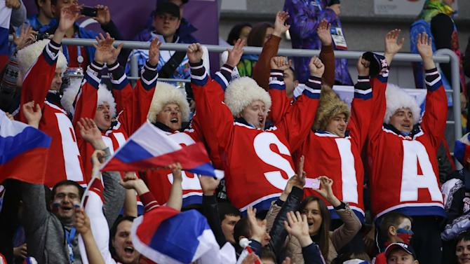 Hockey fans cheer for Russia during a men's ice hockey game against Slovenia at the 2014 Winter Olympics, Thursday, Feb. 13, 2014, in Sochi, Russia