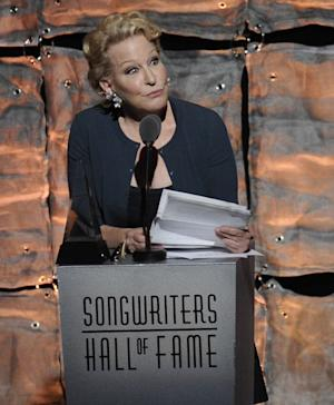 Lifetime Achievement Award inductee Bette Midler accepts her award at the 2012 Songwriters Hall of Fame induction and awards gala at the Marriott Marquis Hotel, Thursday June 14, 2012 in New York. (Photo by Evan Agostini/Invision)