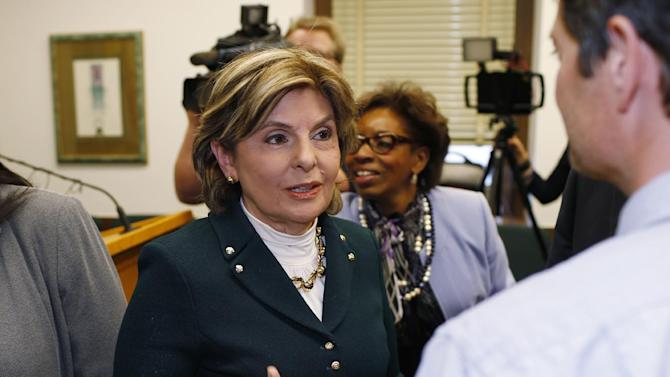 Attorney Gloria Allred, left, talks to reporters after a news conference Thursday, Feb. 11, 2016, in the State Capitol in Denver. Allred and two Denver women, who claim to have been assaulted by comic Bill Cosby, were on hand to testify before a House committee on whether to permit rape victims to seek criminal charges against offenders beyond the state's 10-year statute of limitations. (AP Photo/David Zalubowski)