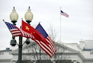File photo of Chinese and US national flags in front of the White House in Washington, DC. The Obama administration has repeatedly urged Beijing to let the yuan appreciate, but has stopped short of declaring China a currency manipulator -- a designation that could trigger sanctions and perhaps an all-out trade war
