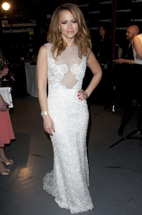 Kimberley Walsh wore a lovely white number to the ceremony / Rex