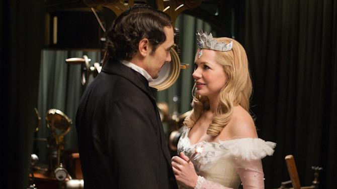 "This film image released by Disney Enterprises shows James Franco, left, and Michelle Williams in a scene from ""Oz the Great and Powerful."" (AP Photo/Disney Enterprises, Merie Weismiller Wallace)"