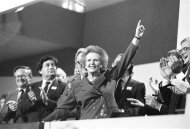 Then British Prime Minister Margaret Thatcher points skyward as she receives standing ovation at Conservative Party Conference in this October 13, 1989 file photo. Thatcher has died following a stroke, a spokesman for the family said. REUTERS/Stringer/Files (BRITAIN - Tags: POLITICS OBITUARY)